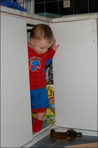 John Thomas standing inside a kitchen cupboard